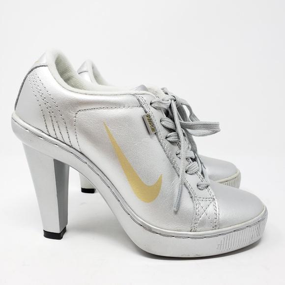 Nike women s high heel sneakers silver yellow 7. M 5c38f4c3035cf1712927b12c fe4a054bb